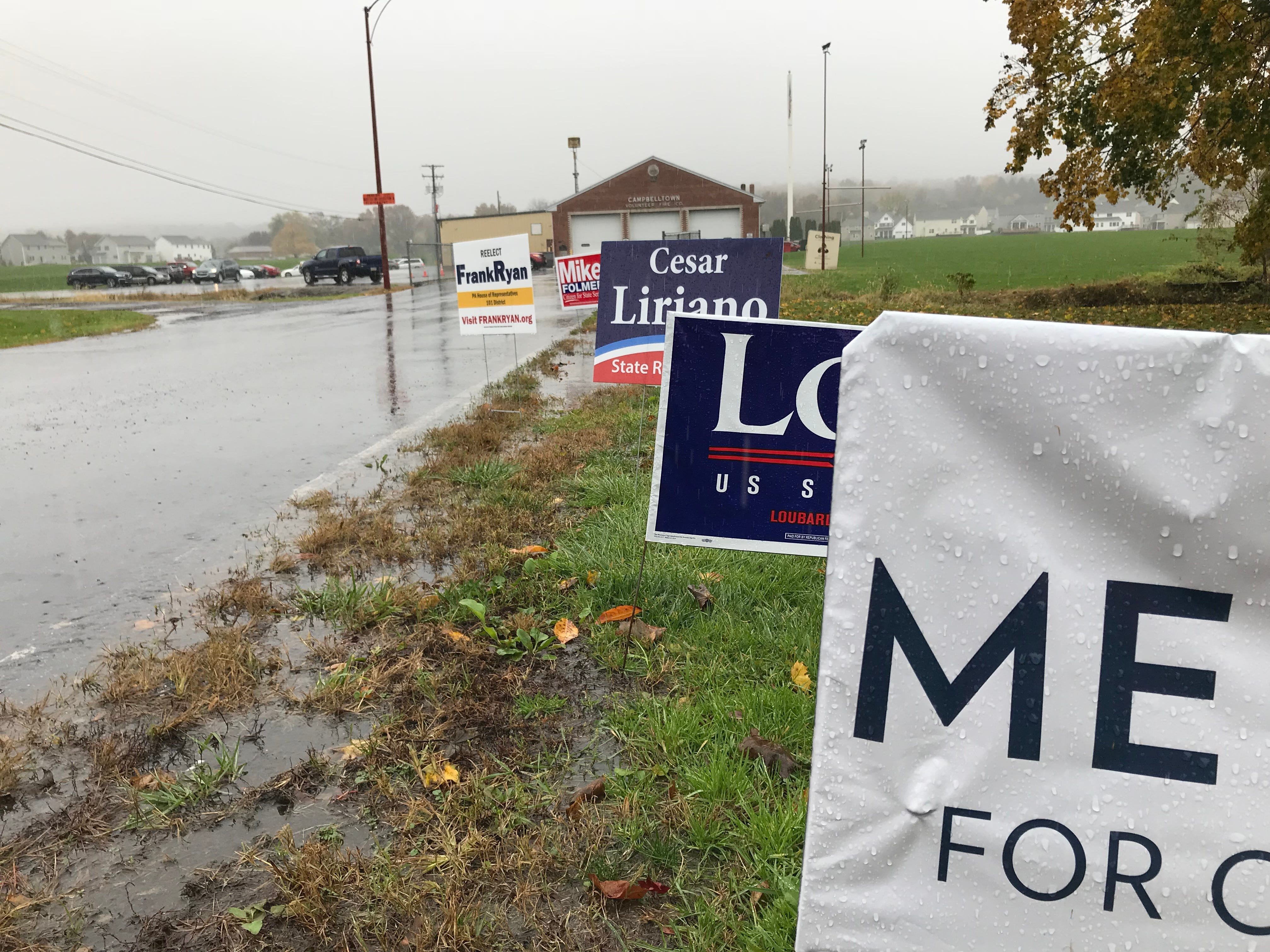 Campaign signs along the driveway at the Campbelltown Fire Company social hall located at 2818 Horseshoe Pike, during the midterm elections Nov. 6, 2018.