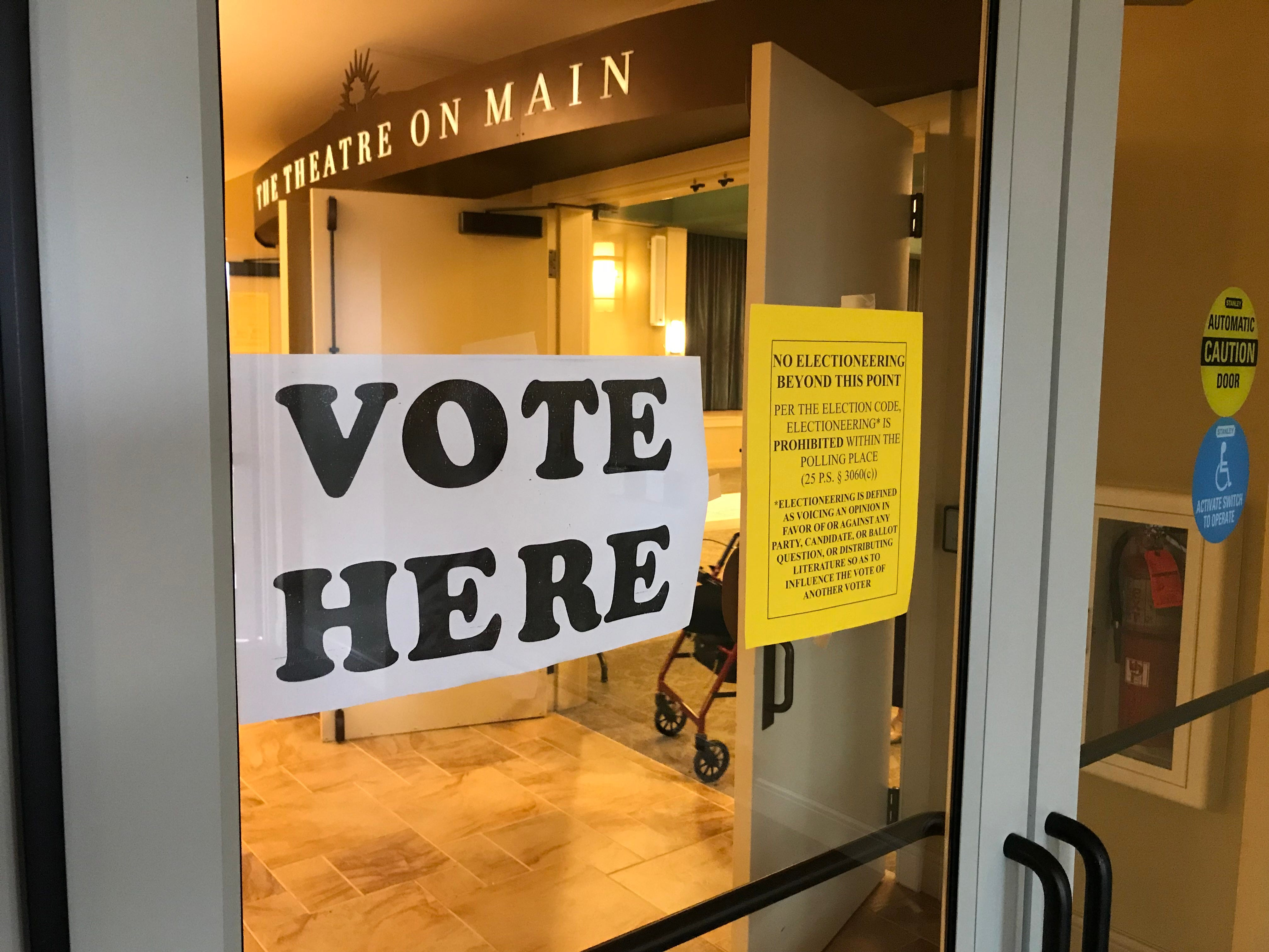 Signs on the doors leading into the polls at StoneRidge Poplar Run, 440 E. Lincoln Ave., in Jackson Township Nov. 6, 2018.