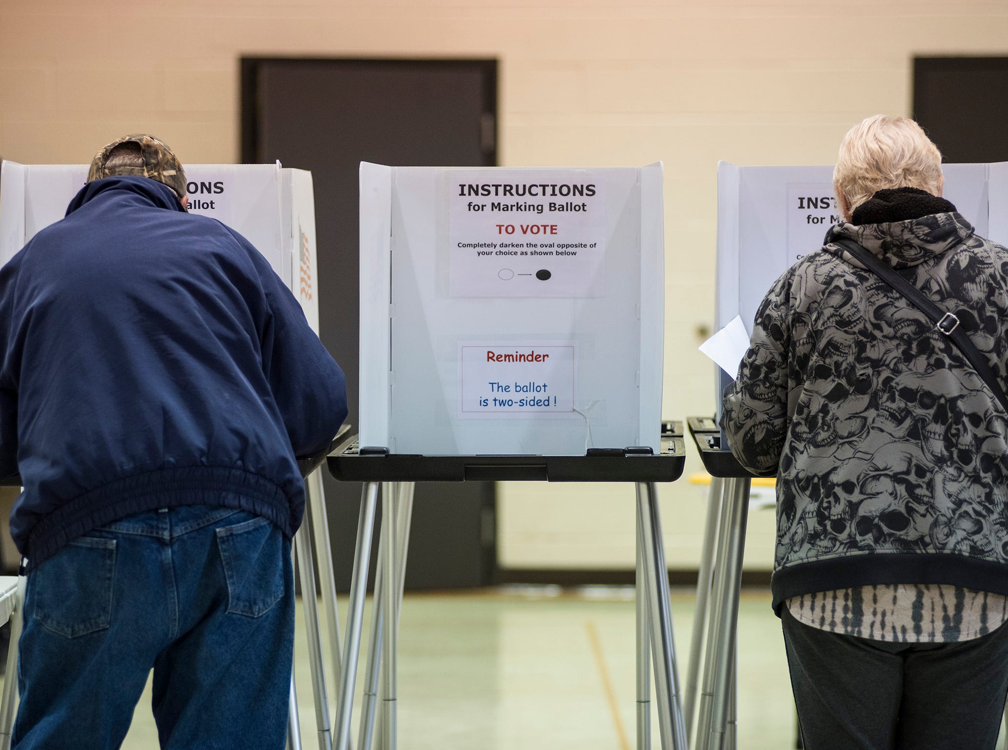 Voters in precinct 6 fill out their ballots at First United Methodist Church in Port Huron during mid-term elections Tuesday, Nov. 6, 2018.