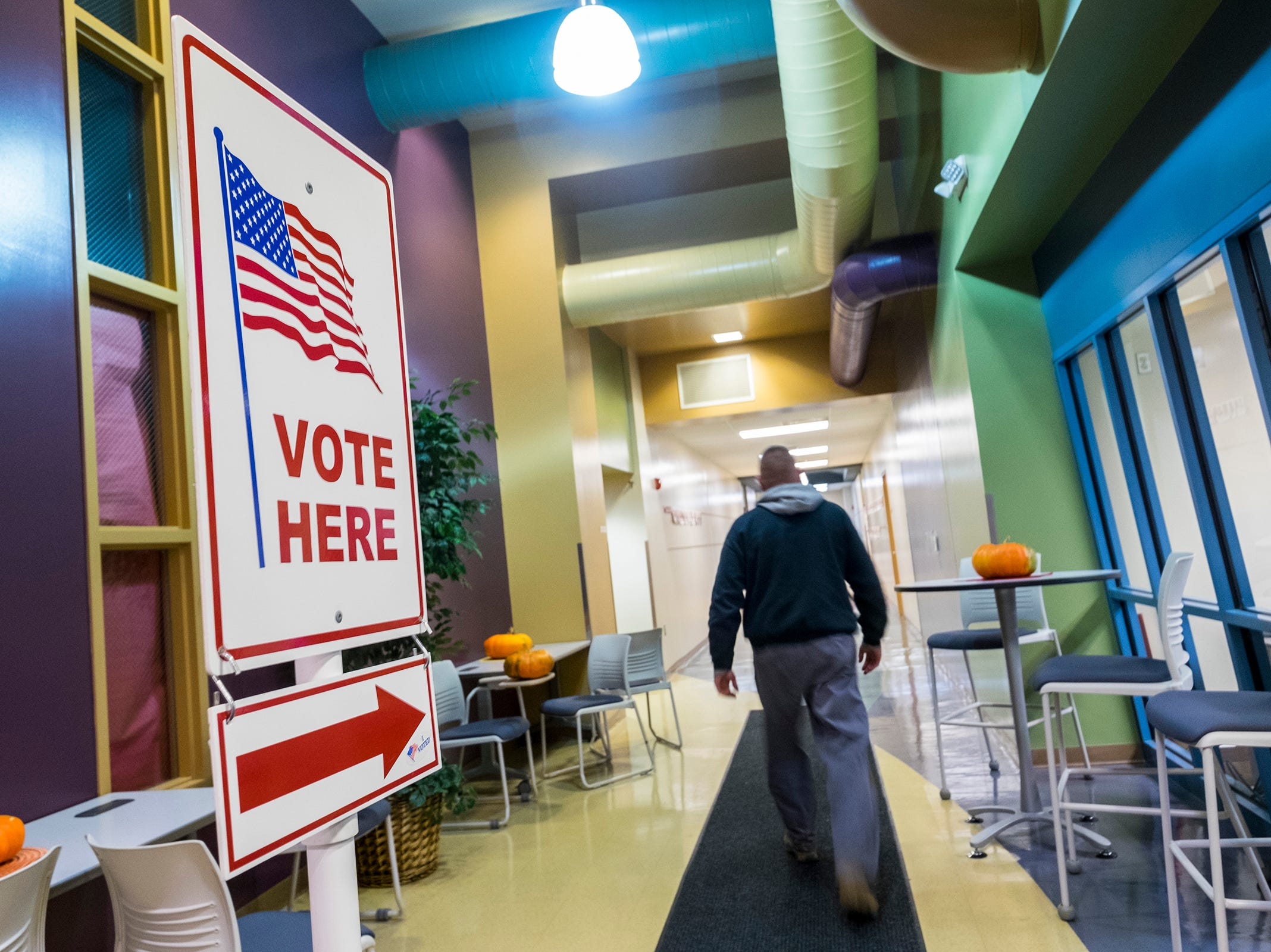 A Port Huron Township voter walks into the precinct 5 polling location Tuesday, Nov. 6, 2018 at the Virtual Learning Academy.