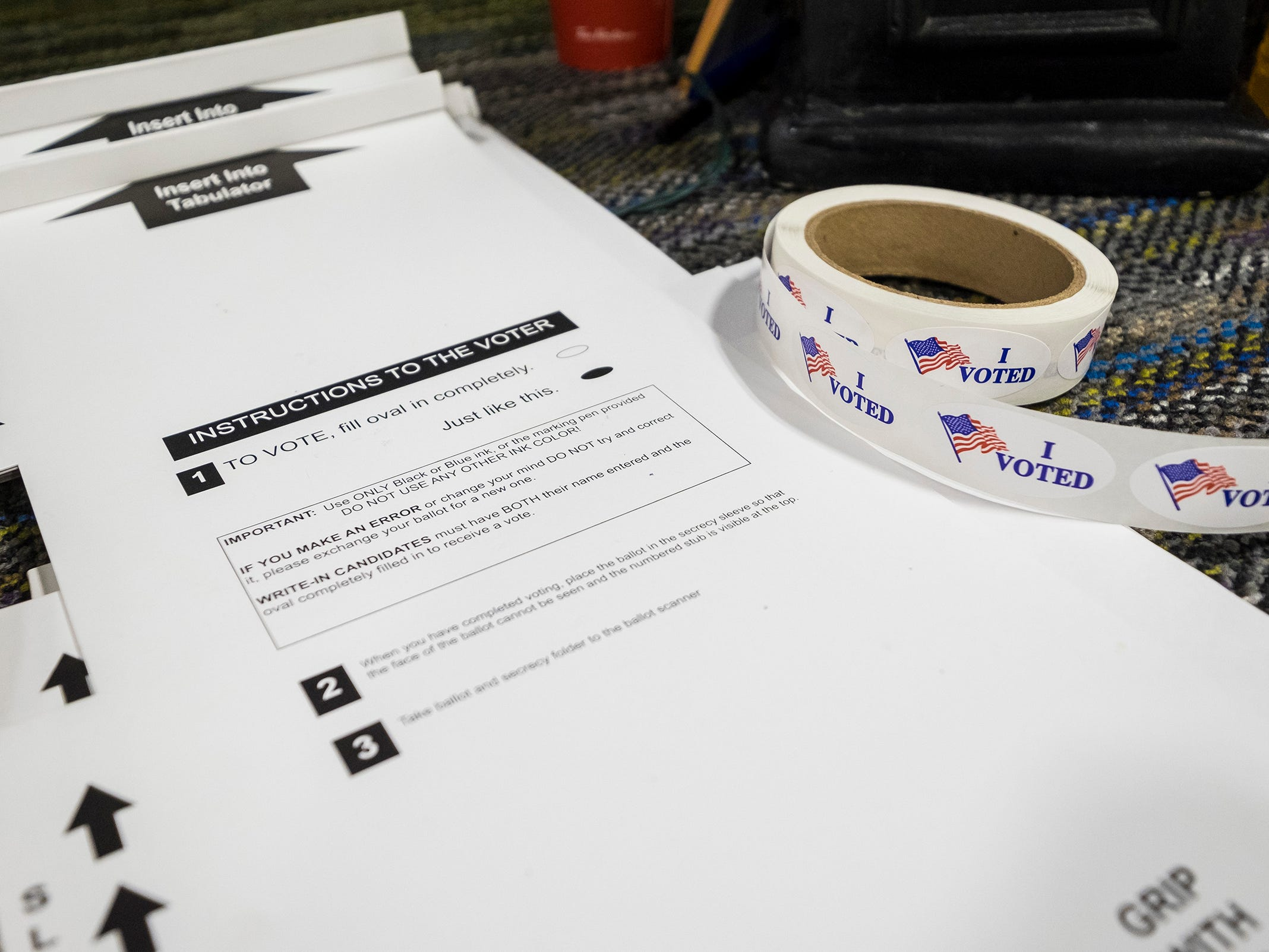 "A roll of ""I Voted"" stickers sits next to blank ballot sleeves Tuesday, Nov. 6, 2018 inside Keewahdin Elementary, which serves as the polling location for precinct 1 in Fort Gratiot."