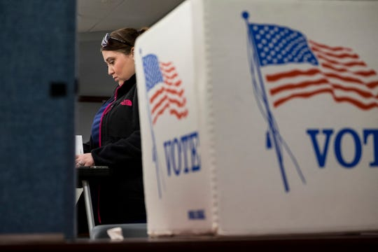 Fort Gratiot resident Heather Clark completes her ballot Tuesday, Nov. 6, 2018 at the precinct 3 voting location at Fort Gratiot Municipal Center.