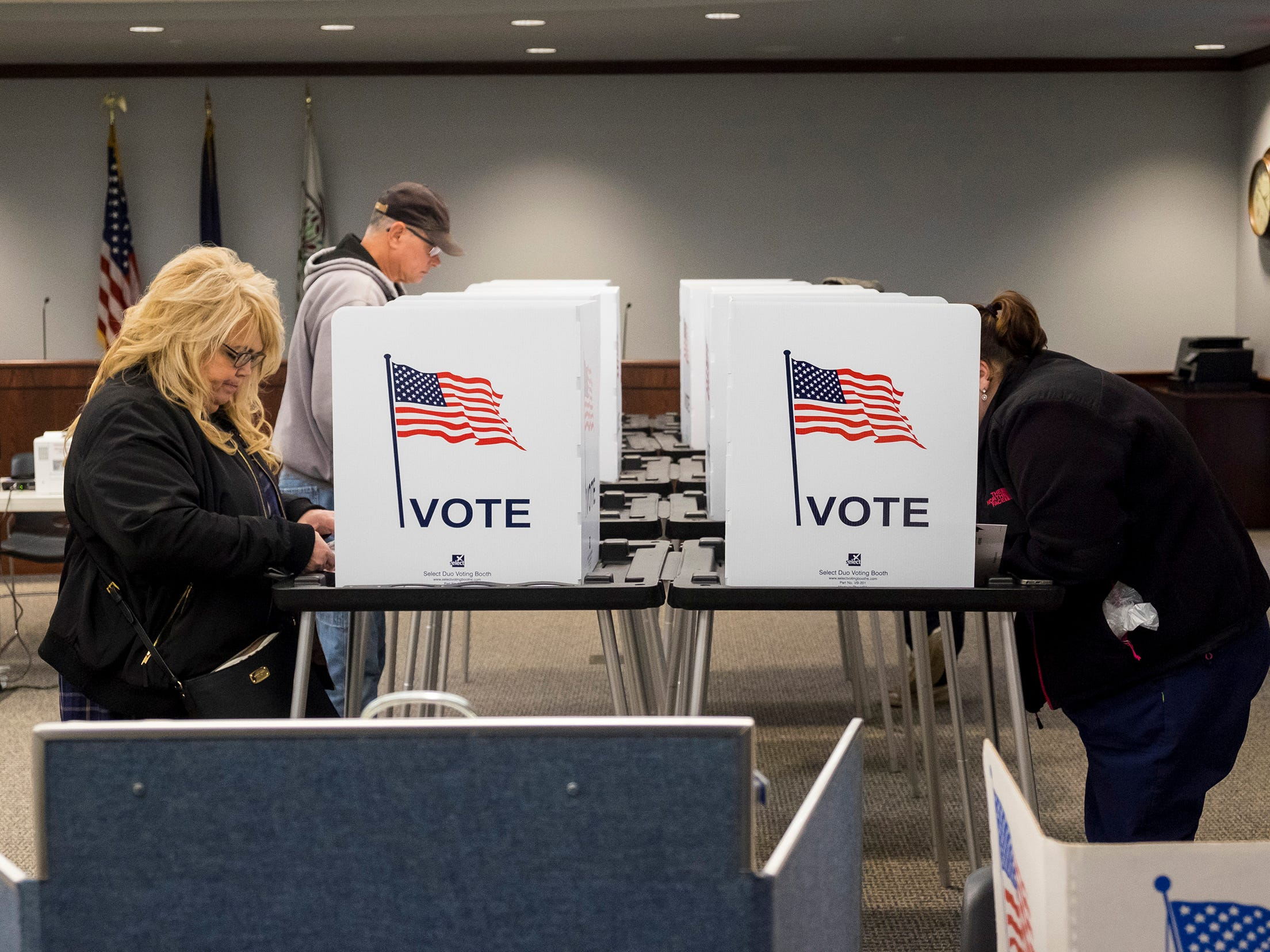 Fort Gratiot residents Tanya Stover, left, and Heather Clark fill out their ballots Tuesday, Nov. 6, 2018 at precinct 3 in the Fort Gratiot Municipal Center.