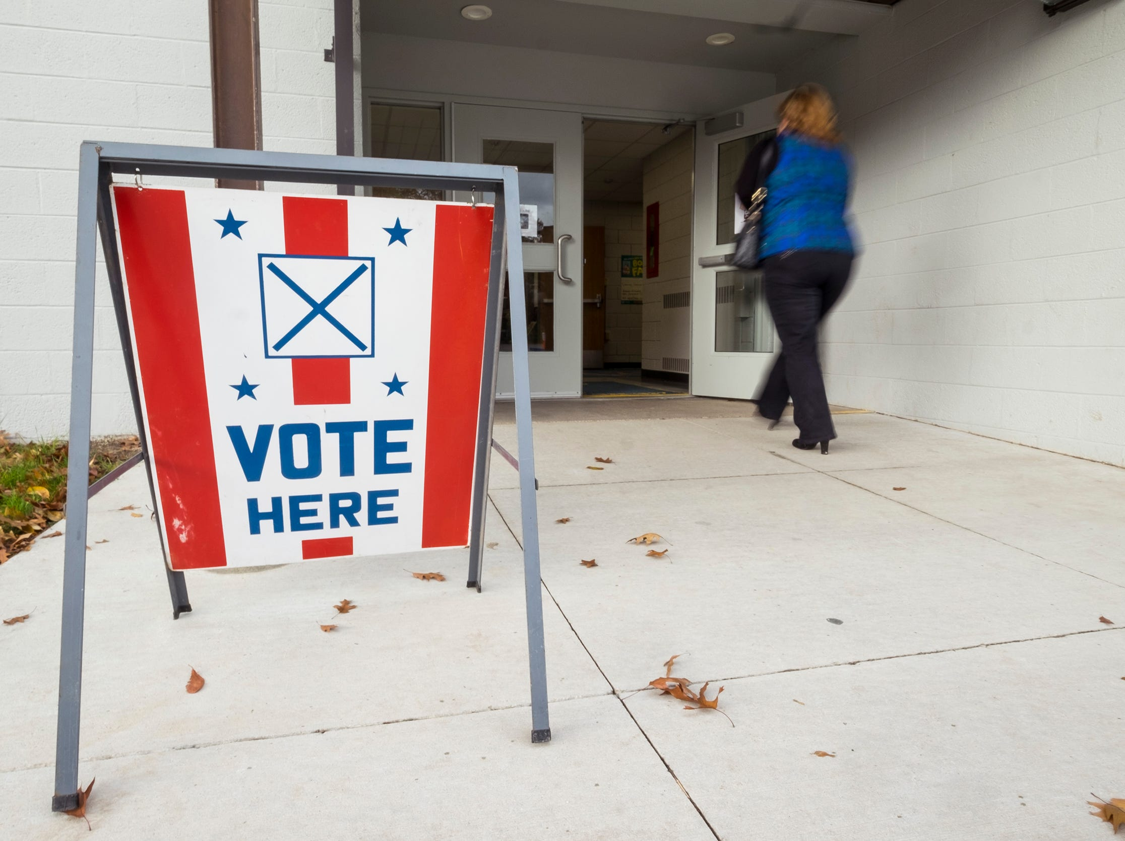 A voter walks into the precinct 1 voting location at Keewahdin Elementary Tuesday, Nov. 6, 2018 during mid-term elections.