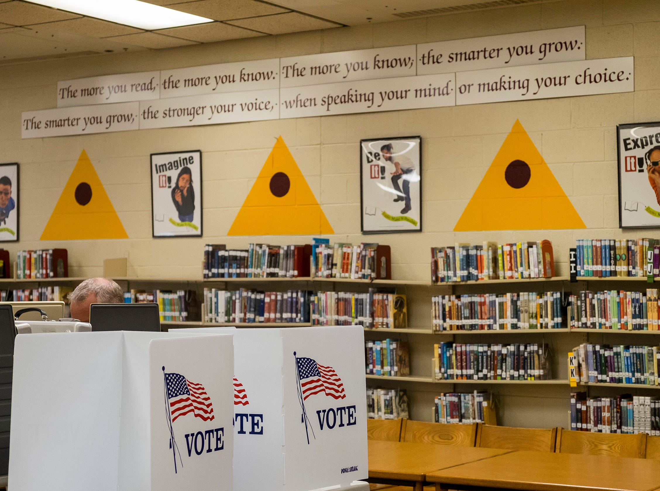 A Fort Gratiot resident fills out his ballot Tuesday, Nov. 6, 2018 at the precinct 2 voting location in Fort Gratiot Middle School.