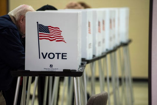 Voters in precinct 2 fill out their ballots at Colonial Woods Missionary Church in Port Huron during mid-term elections Tuesday, Nov. 6, 2018.