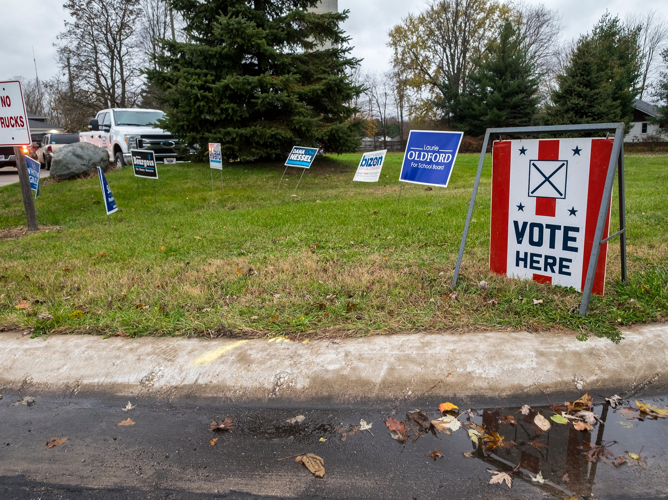 Signs supporting candidates are staked into the grass outside of the Port Huron Township Department of Public Works office Tuesday, Nov. 6, 2018 during mid-term elections.