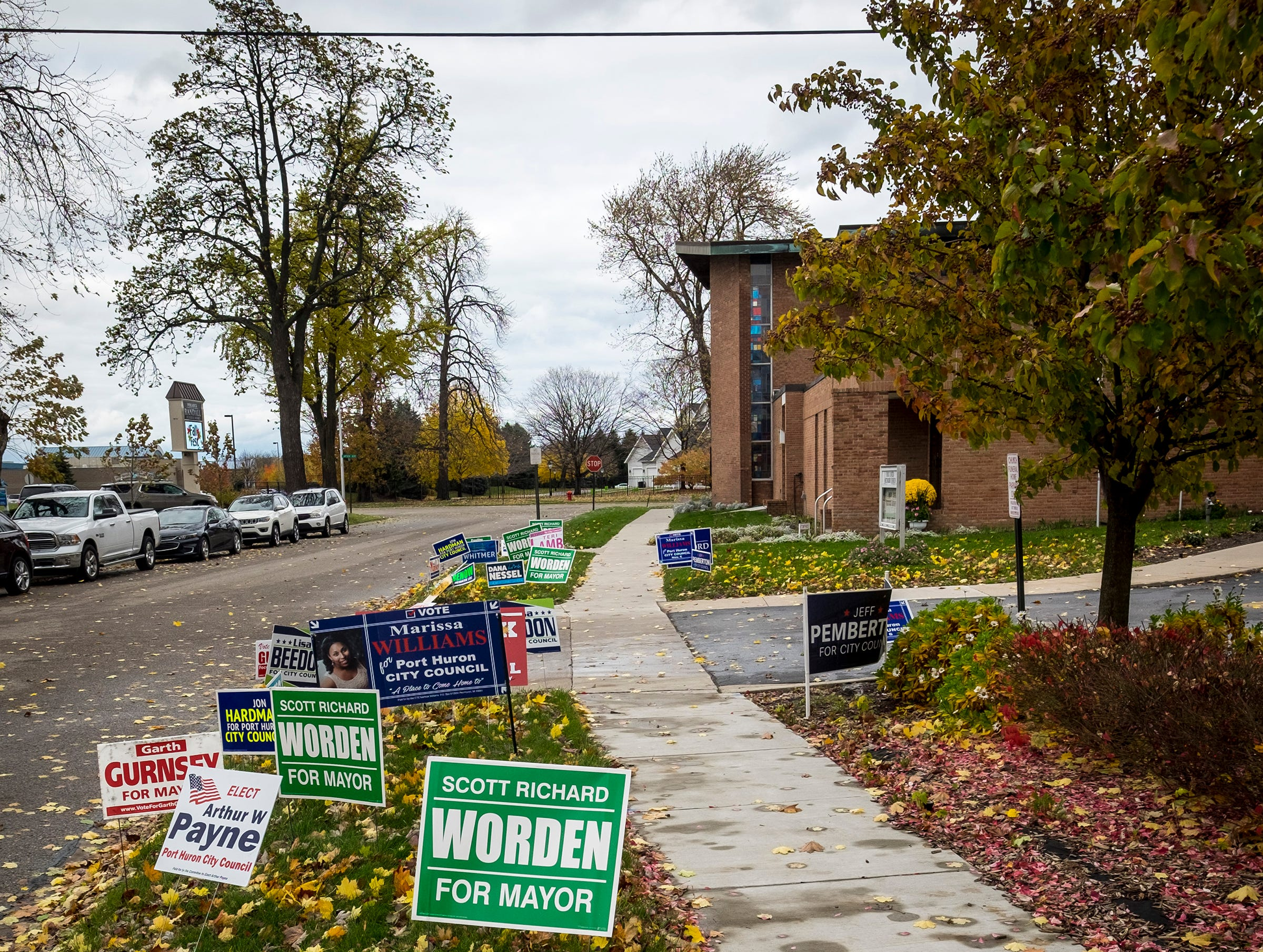 Signs supporting candidates line the grass outside of the First United Methodist Church in Port Huron, which is the voting location for precincts 6 and 7 during mid-term elections Tuesday, Nov. 6, 2018.