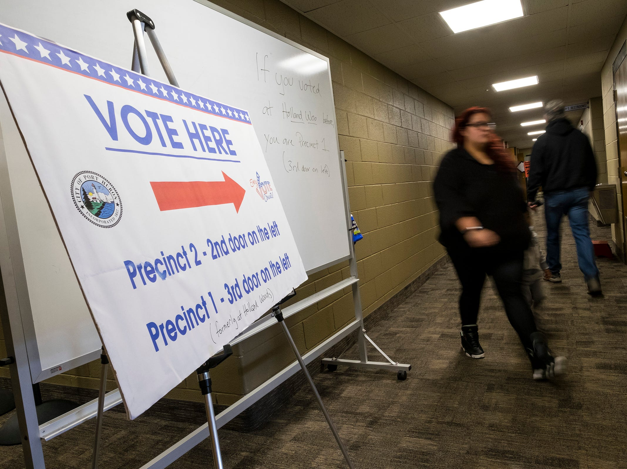 Voters walk through the hallway at Colonial Woods Missionary Church, where the voting locations for precincts 1 and 2 are during the mid-term elections Tuesday, Nov. 6, 2018.