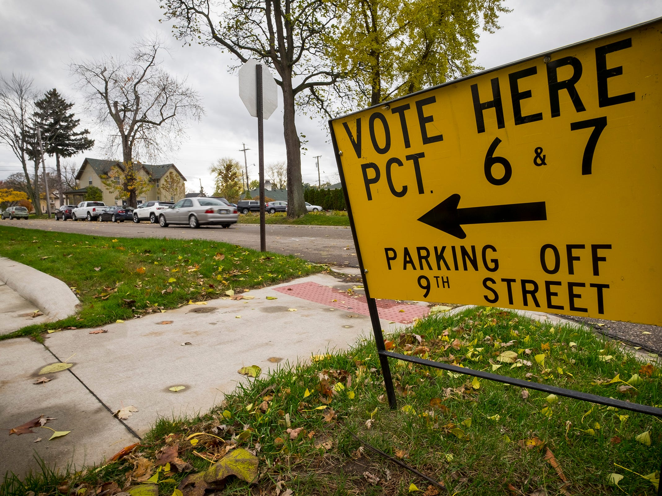 A car drives down Ninth Street in Port Huron towards First United Methodist Church, which serves as the voting location for precincts 6 and 7 Tuesday, Nov. 6, 2018 during mid-term elections.