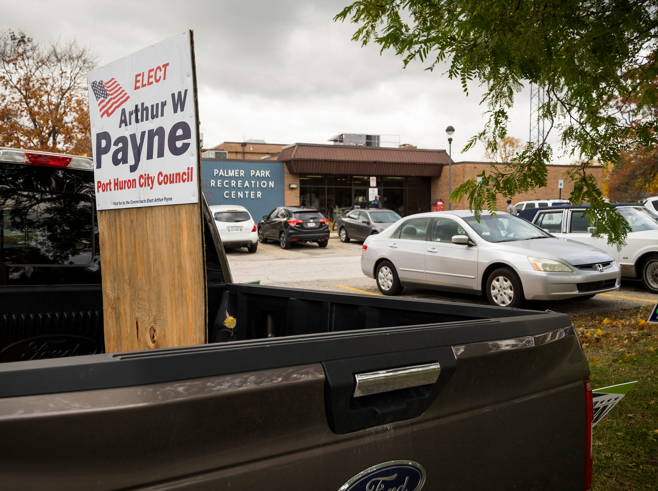 A sign supporting Arthur Payne for Port Huron City Council is mounted on a piece of wood in the bed of a pickup truck parked outside Palmer Park Recreation Center Tuesday, Nov. 6, 2018 during mid-term elections.