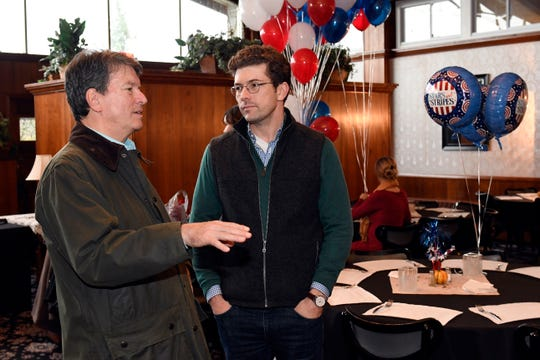 Rep. John Faso, left, talks with his son Nicholas Faso as family members set up his election night Republican headquarters in Valatie on Tuesday.