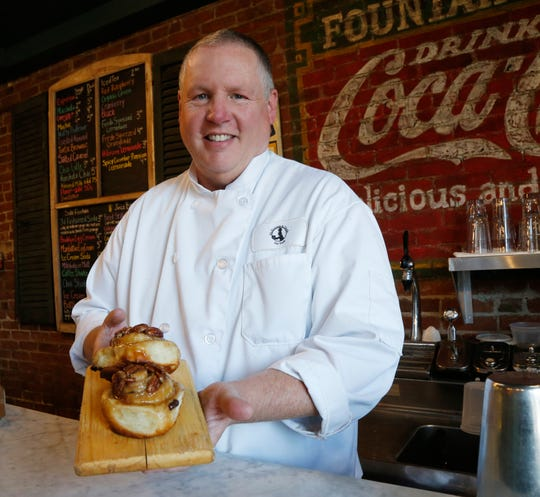 Shannon McKinney with some of his popular sticky buns at McKinney & Doyle Fine Foods in Pawling on October 31, 2018.