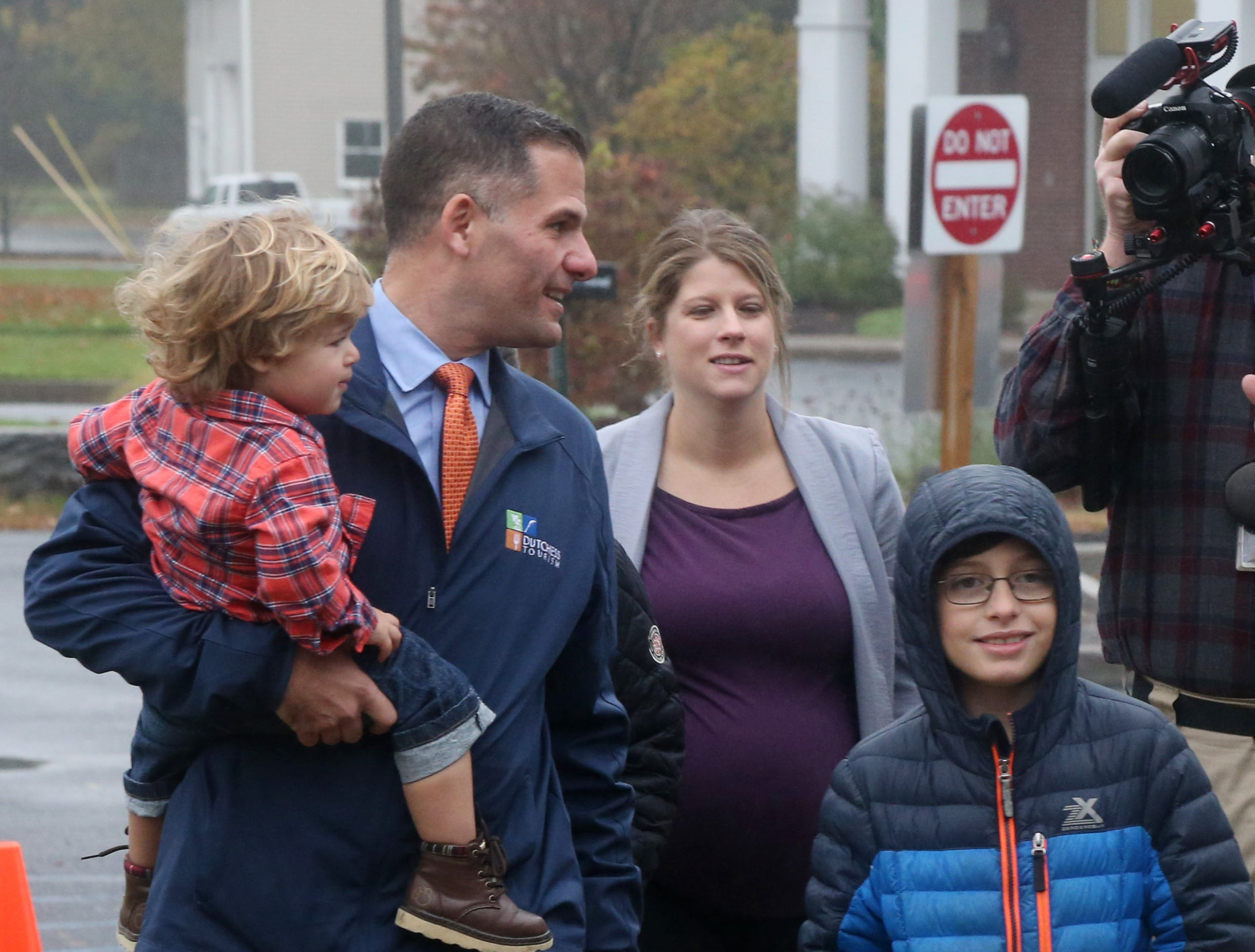 Republican Gubernatorial candidate Marc Molinaro walks in to Red Hook Town Hall to cast his ballot on November 6, 2018. Molinaro holds his son Elias, and is followed by his wife Corinne and son Jack