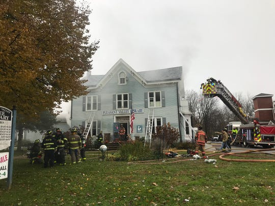 Multiple agencies battled a fire at Pleasant Valley Library on Tuesday.