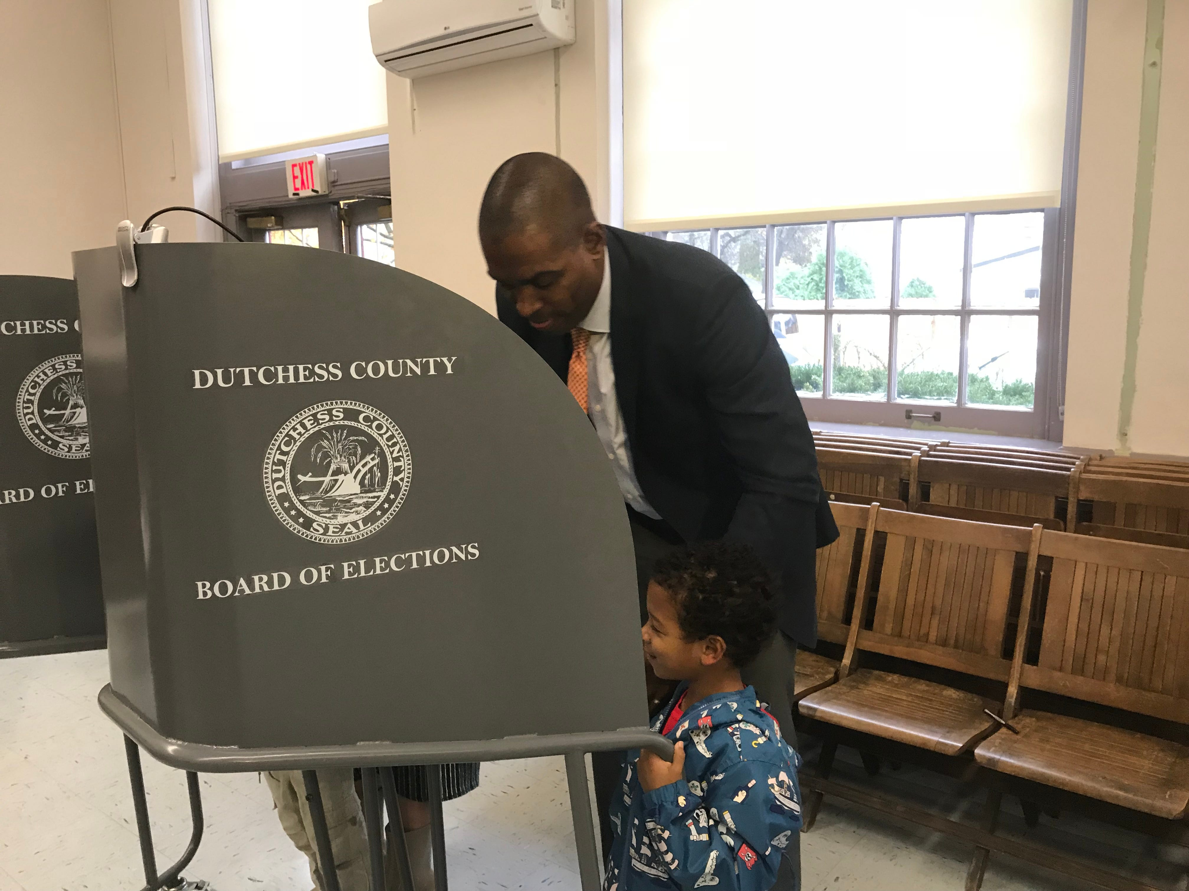Antonio Delgado of Rhinebeck, Republican candidate for the 19th Congressional District, votes at Rhinebeck Town Hall Tuesday morning with his 5-year-old son.