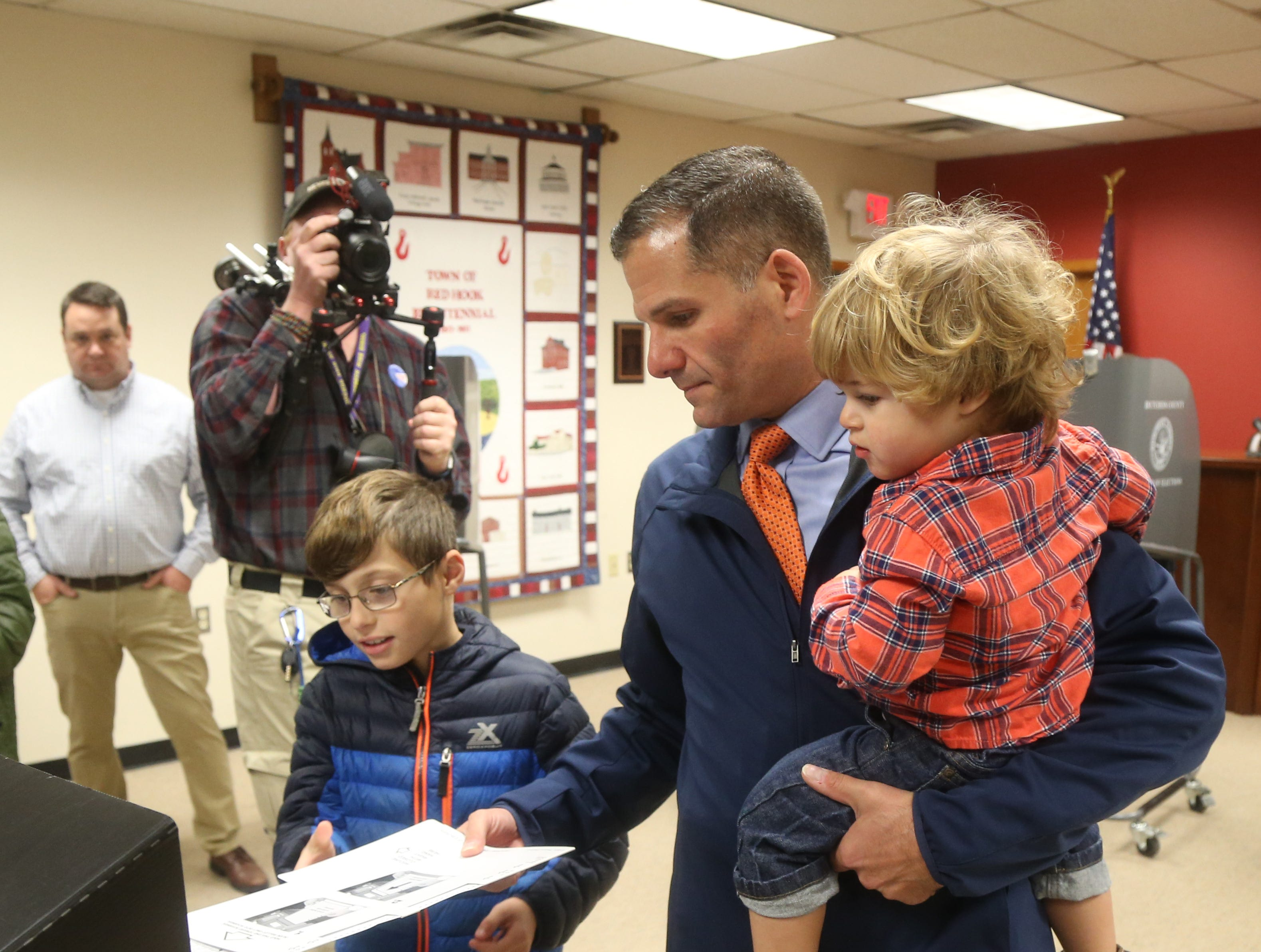 Republican gubernatorial candidate Marc Molinaro with his sons, from left, Jack and Elias, casts his ballot Tuesday at Red Hook Town Hall.