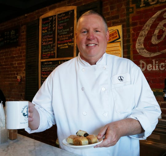 Shannon McKinney with a cup of coffee and a plate of rugelach at McKinney & Doyle Fine Foods in Pawling on October 31, 2018.
