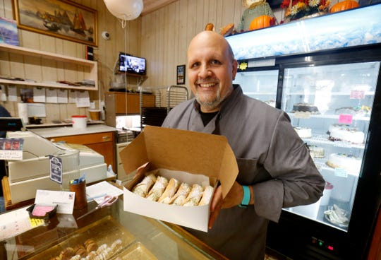Owner of La Deliziosa Italian Pastry Shop in the City of Poughkeepsie, Frank Cordaro holds a tray of freshly filled cannoli on October 30, 2018.