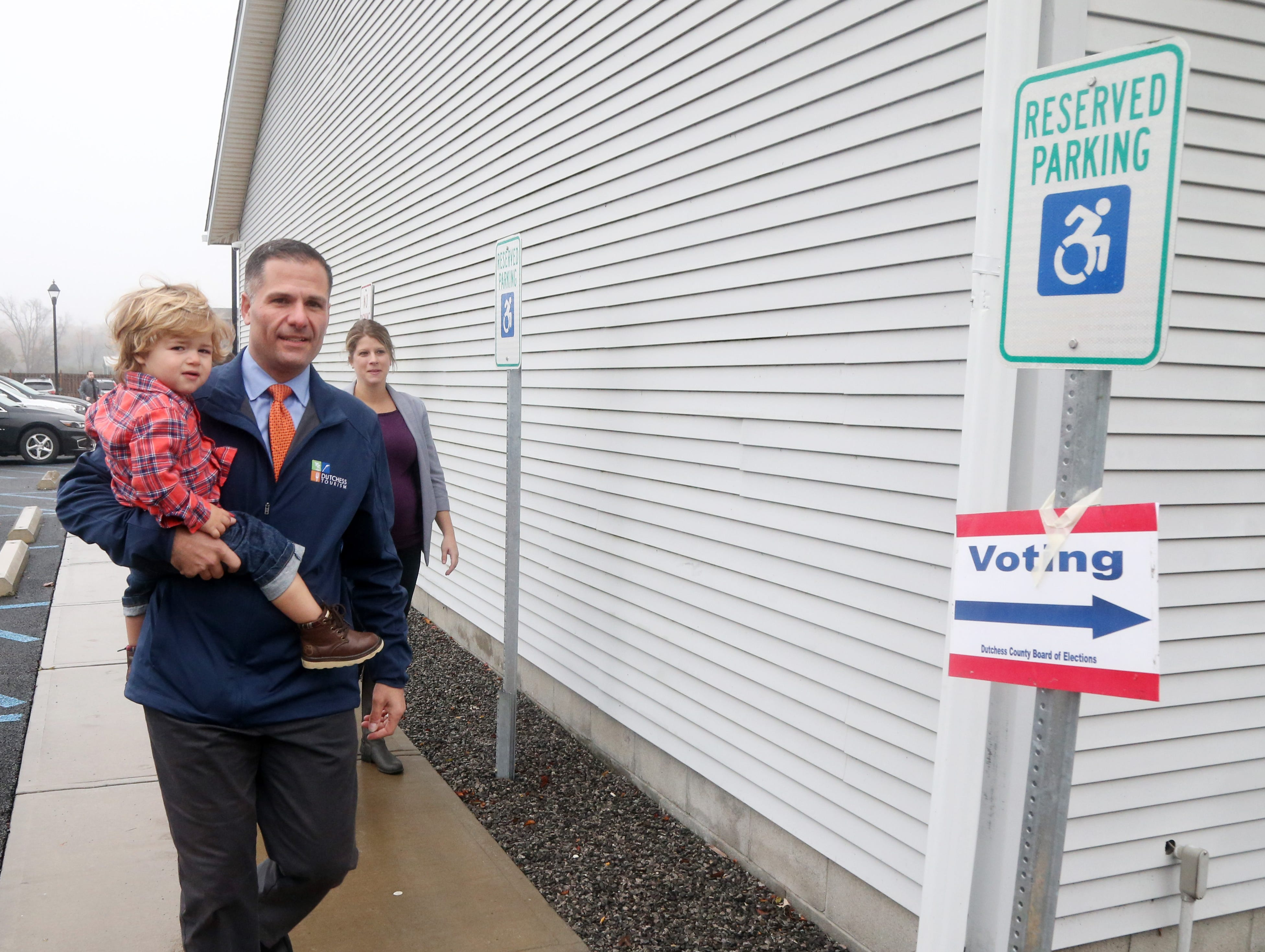 Republican Gubernatorial candidate Marc Molinaro walks to Red Hook Town Hall to cast his ballot on November 6, 2018. Molinaro holds his son Elias.
