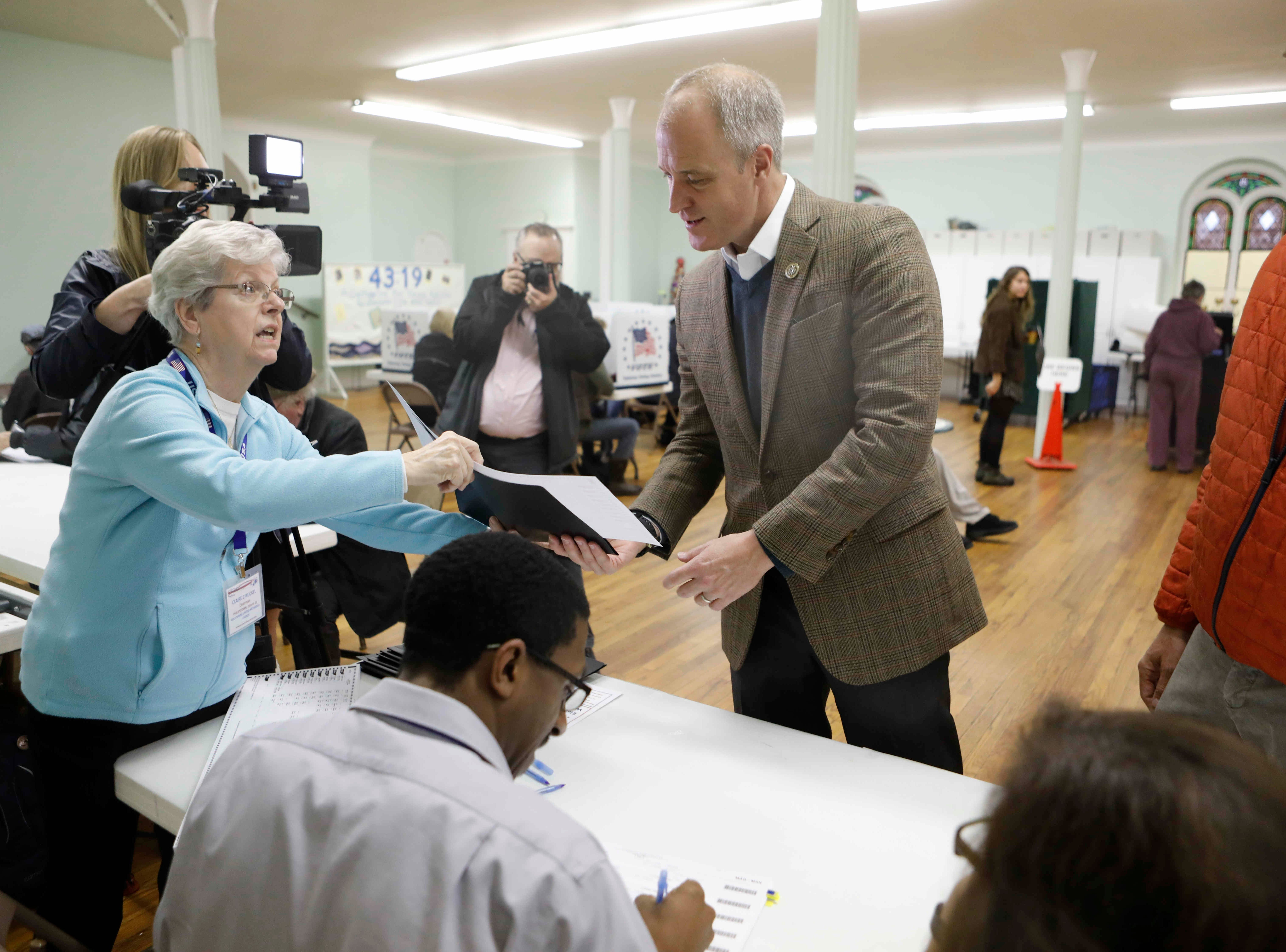 Congressman Sean Patrick Maloney prepares to cast his vote at the United Methodist Church polling station in Cold Spring on Nov. 6, 2018.