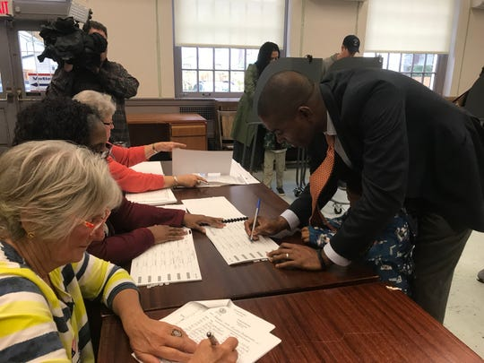 Antonio Delgado of Rhinebeck, Republican candidate for the 19th Congressional District, signs in to vote at Rhinebeck Town Hall Tuesday morning.
