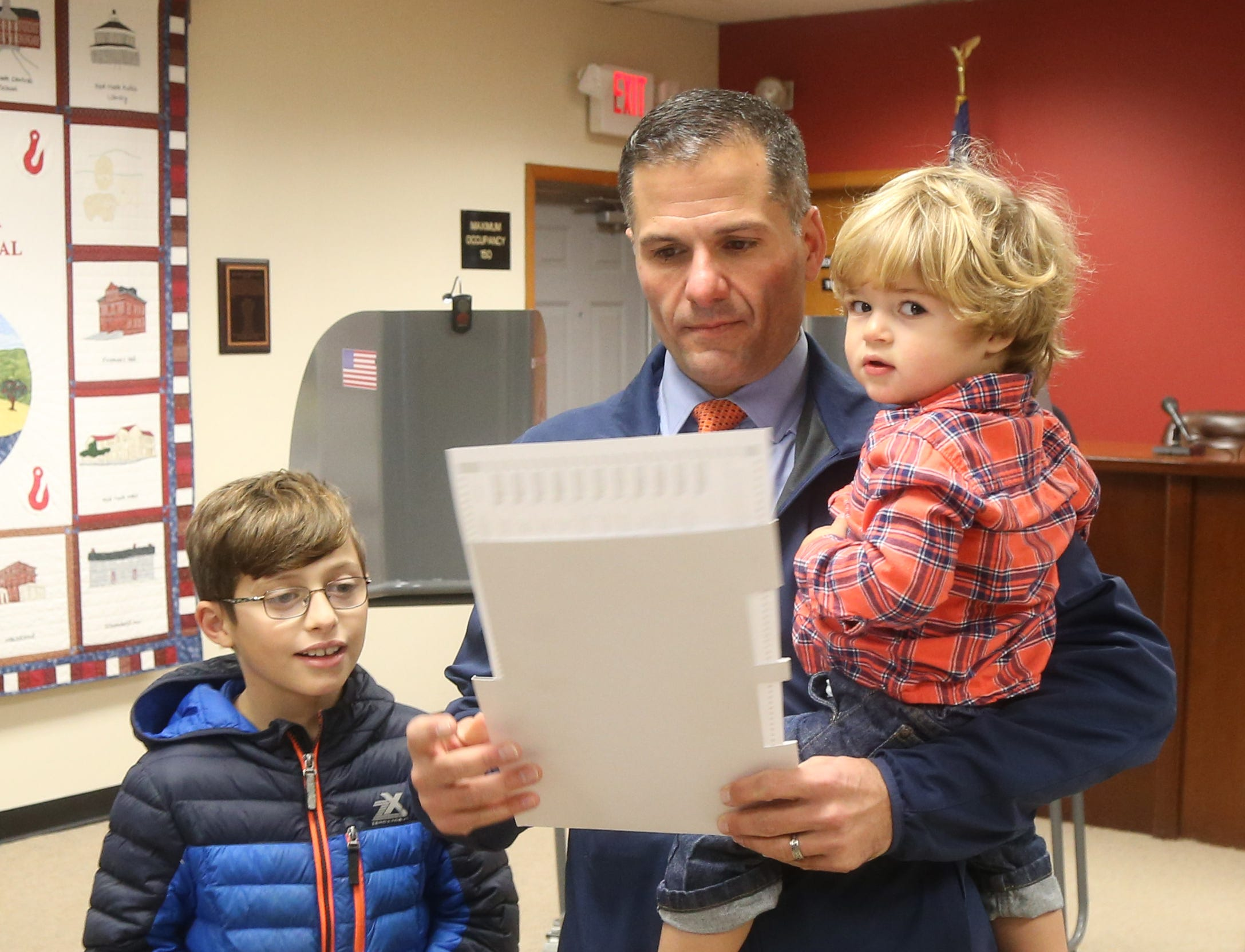 Republican gubernatorial candidate Marc Molinaro with his sons, from left, Jack and Elias, casts hs ballot Tuesday at Red Hook Town Hall.