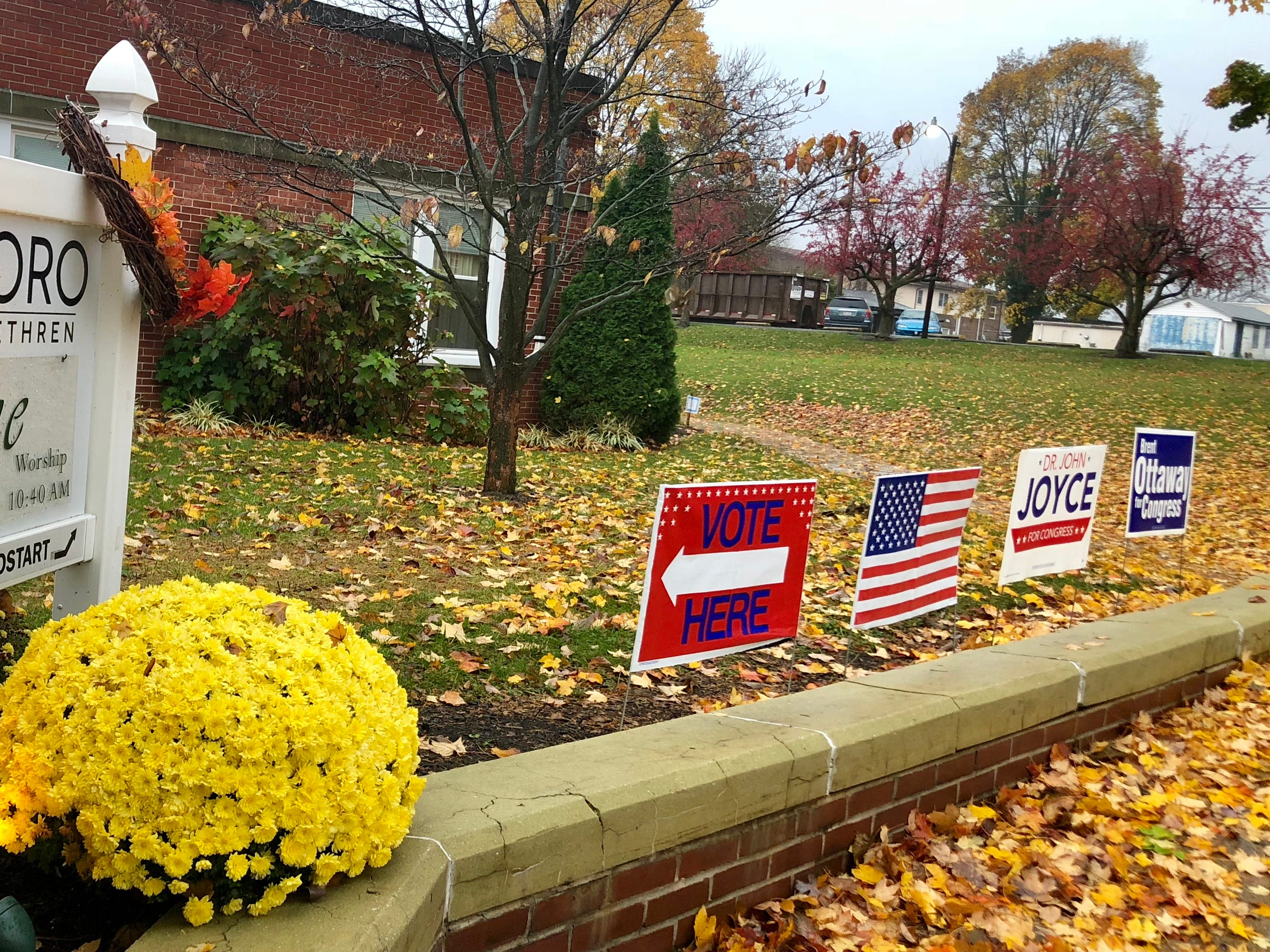Signs sit out in front of the Waynesboro Church of the Brethren during the mid-term election the morning of Tuesday, Nov. 6, 2018.