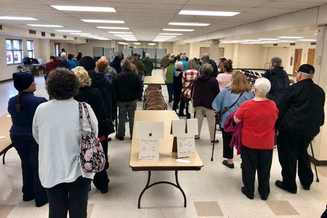 Residents line up to vote in the mid-term election at the Chambersburg recreation center the morning of Tuesday, Nov. 6, 2018.