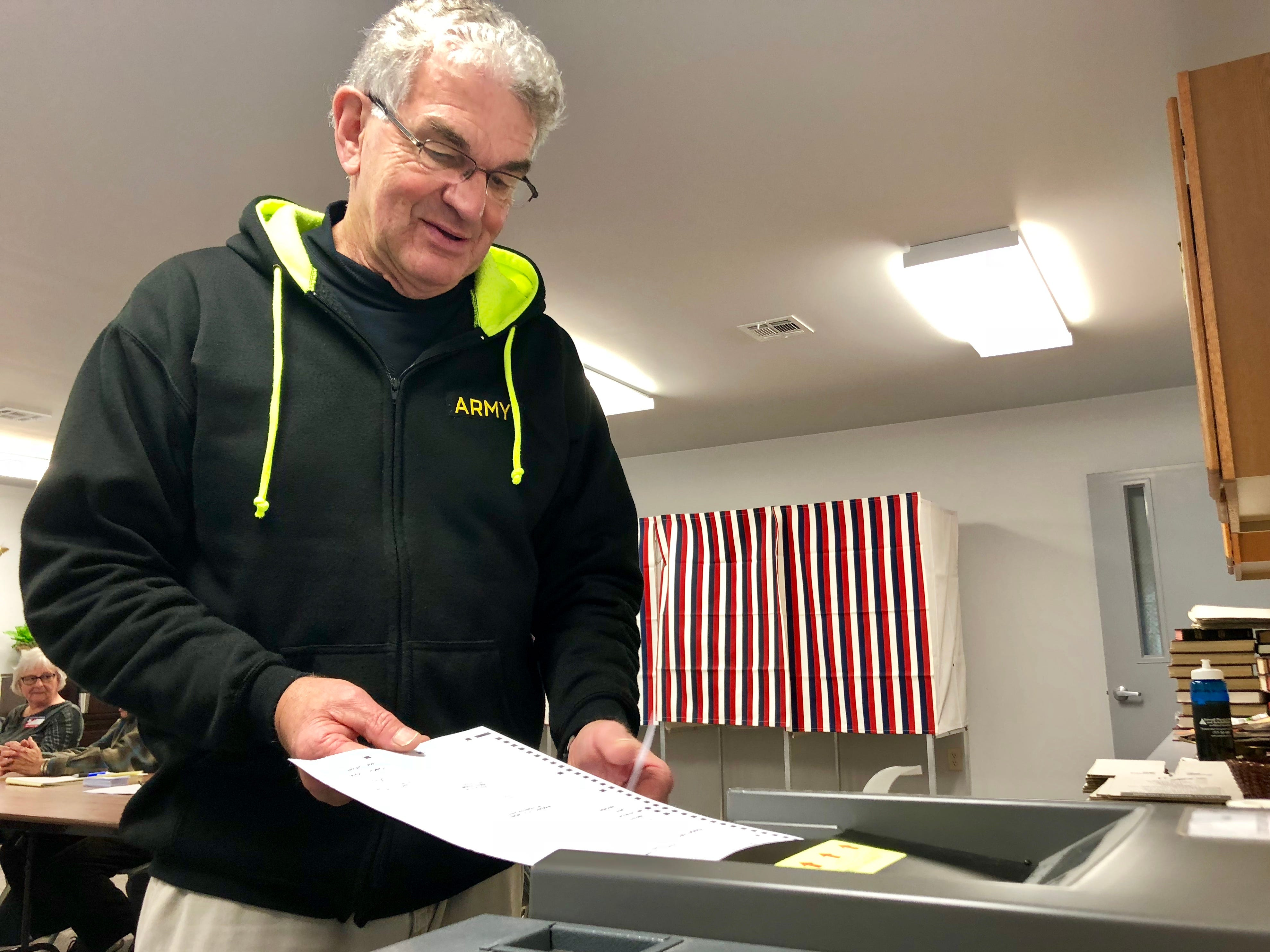 Greencastle resident William Derrick puts his ballot into the scanner at the Greencastle Church of the Brethren during the mid-term election the morning of Tuesday, Nov. 6, 2018.