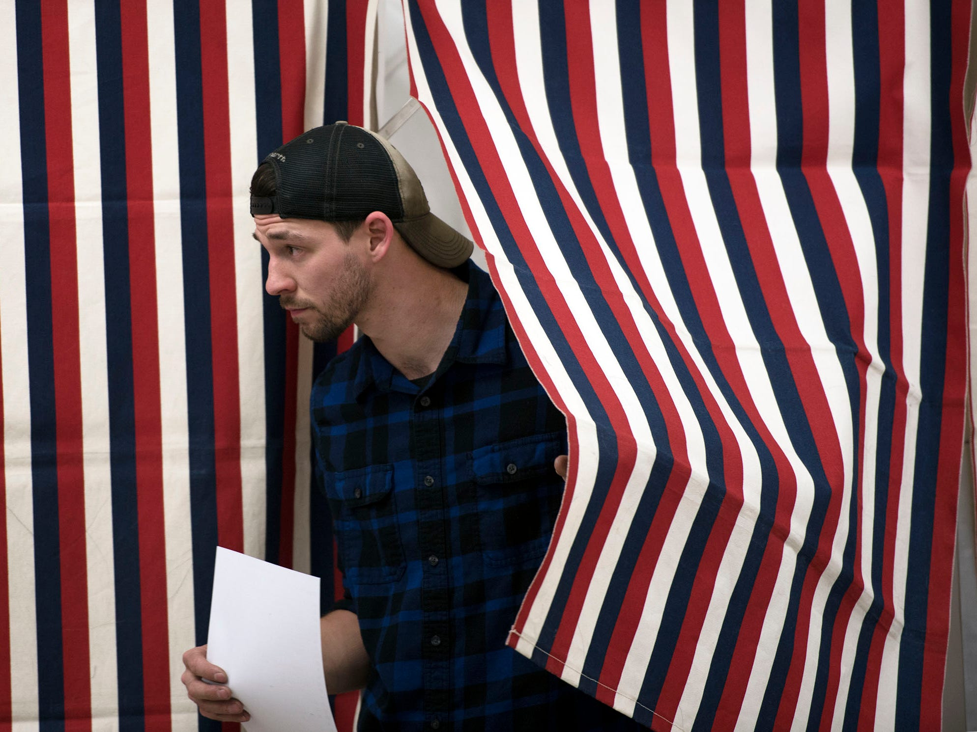 Casey King leaves the ballot booth to casts his ballot on Election Day 2018 at Fayetteville Volunteer Fire Company's events center, Fayetteville.