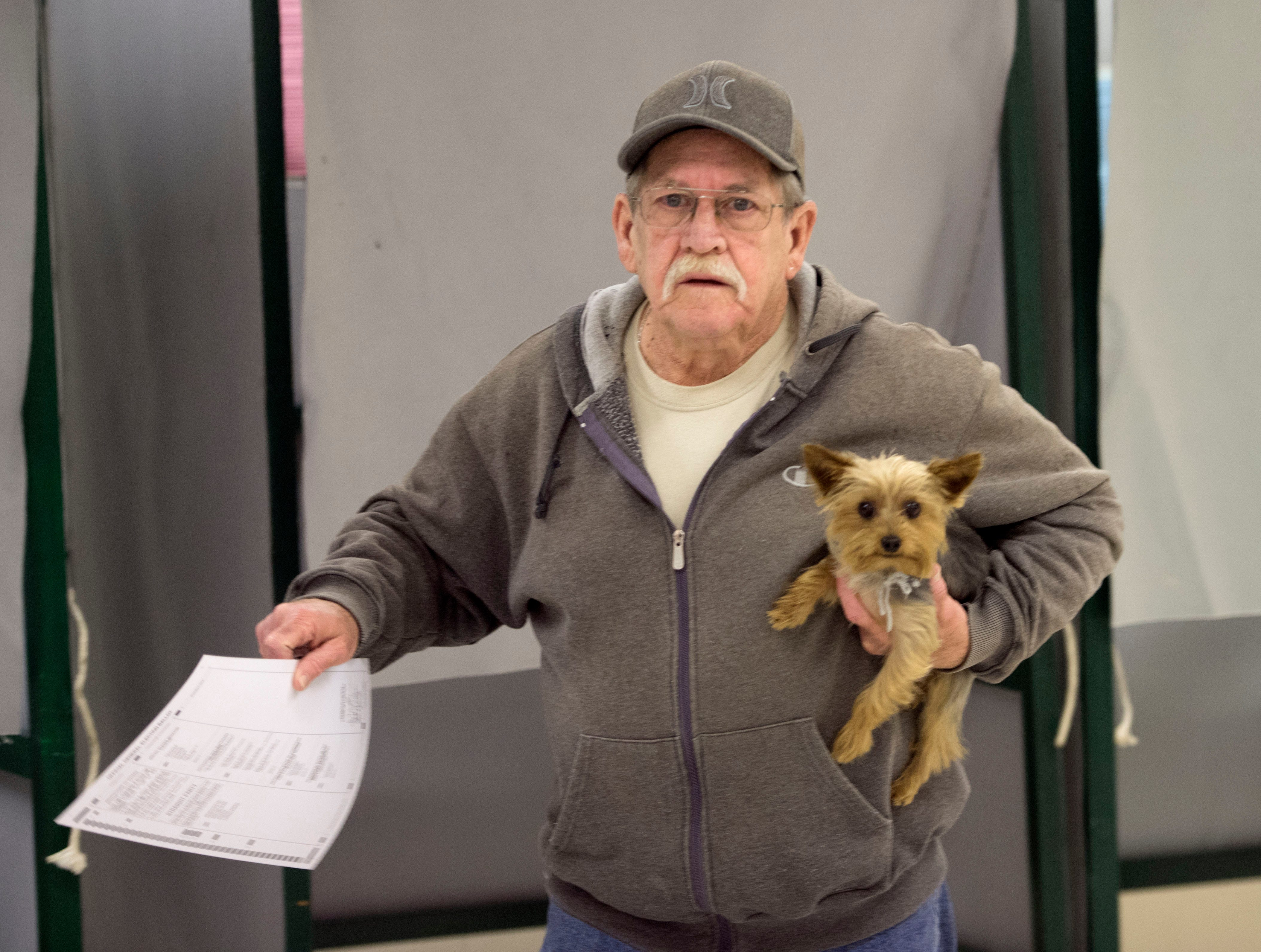 Terry Shew brought along his dog, Braxtyn, as he voted on Tuesday, November 6, 2018. Voters are casting their ballots on Election Day 2018 at Eugene C. Clarke Community Center, Chambersburg.