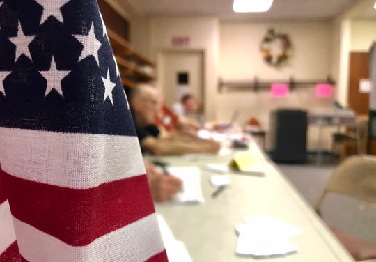 Election officials work at Waynesboro Church of the Brethren during the mid-term election the morning of Tuesday, Nov. 6, 2018.  Majority Inspector Don Rhines said by 7 a.m., the poll had several people lined up to vote.