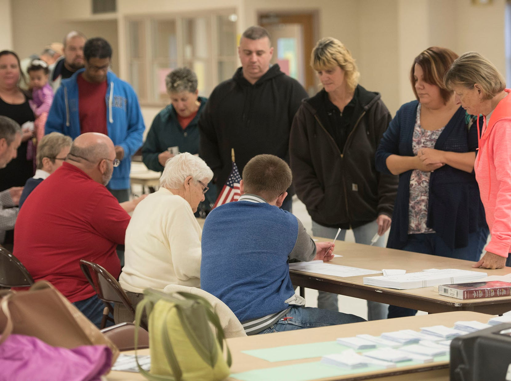 Registered voters lineup to get their ballots. Voters are casting their ballots on Election Day 2018 at Eugene C. Clarke Community Center, Chambersburg.