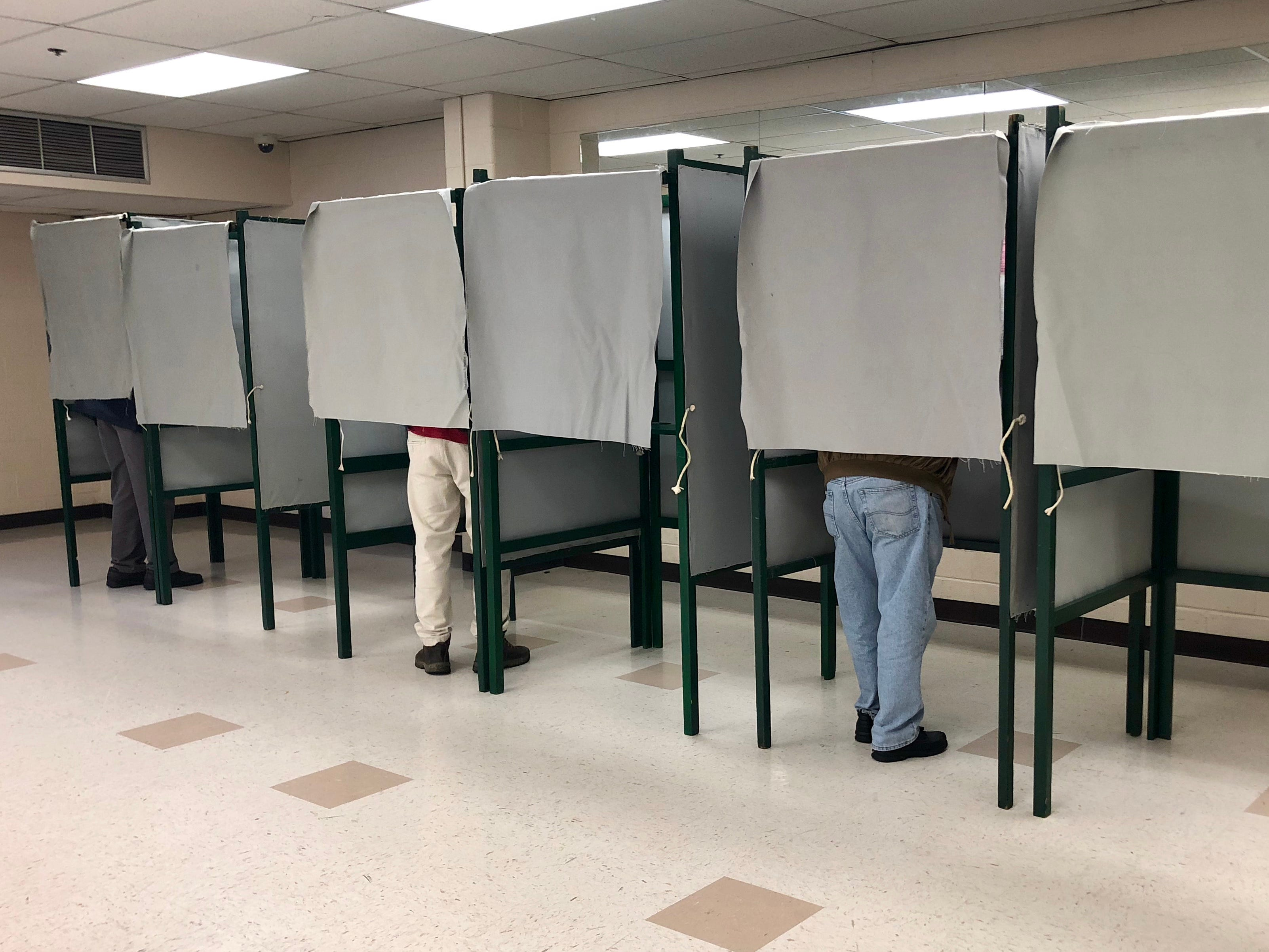 Several residents vote in the mid-term election at the Chambersburg recreation center the morning of Tuesday, Nov. 6, 2018.