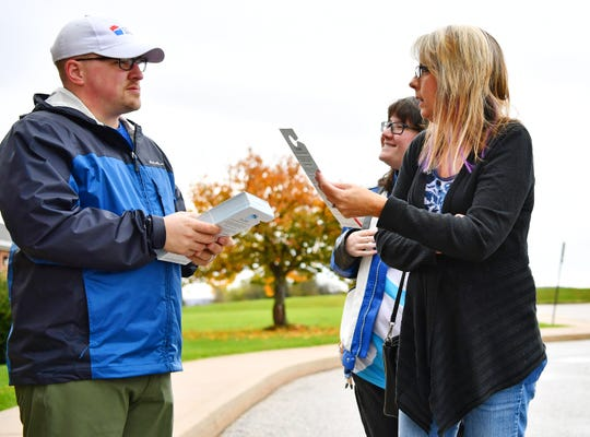 Democratic 47th District state House candidate Michael Wascovich, left, greets Lisa Smeltzer, right, and her daughter Jade Collier, both of Manchester Township, prior to the duo casting their votes in the midterm election at Zion Lutheran Church in Manchester Township Tuesday, Nov. 6, 2018. Dawn J. Sagert photo