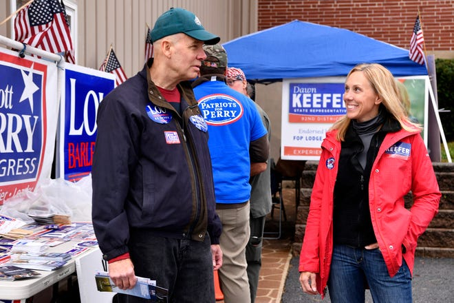 Rep. Dawn Keefer, R - Dillsburg, talks with pollster Steve Becker, also of Dillsburg, outside the Franklin Township polling location, Tuesday, November 6, 2018. John A. Pavoncello photo``