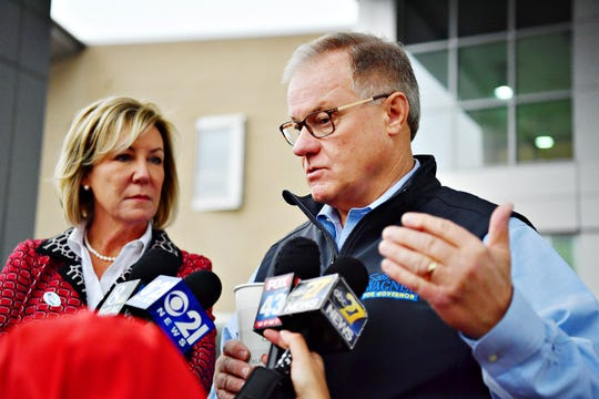 Tracy Wagner, left, looks on as her husband, Republican candidate for Governor of Pennsylvania Scott Wagner addresses media after casting his vote at Grumbacher Sport and Fitness Center in Spring Garden Township, Tuesday, Nov. 6, 2018. Dawn J. Sagert photo