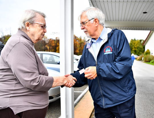 """""""Red or blue?,"""" said Jean Poholsky, left, of Windsor Township, when greeted by Democratic 94th District state House candidate Steve Snell, before casting her vote in the midterm election, at Grace Baptist Church in Windsor Township Tuesday, Nov. 6, 2018. Dawn J. Sagert photo"""