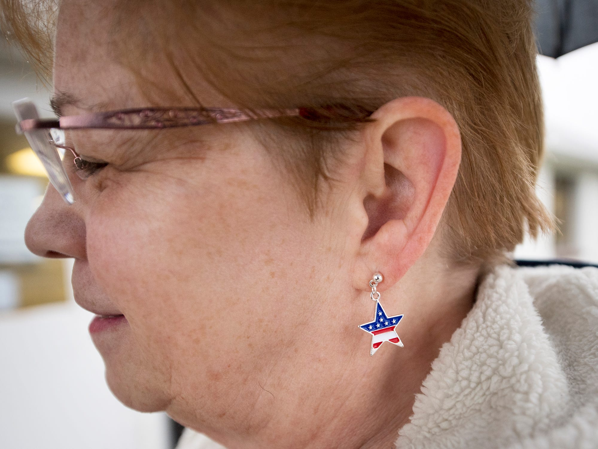 Kathy Zeiders wore patriotic earrings under an umbrella on Election Day in Thomasville where she voted.
