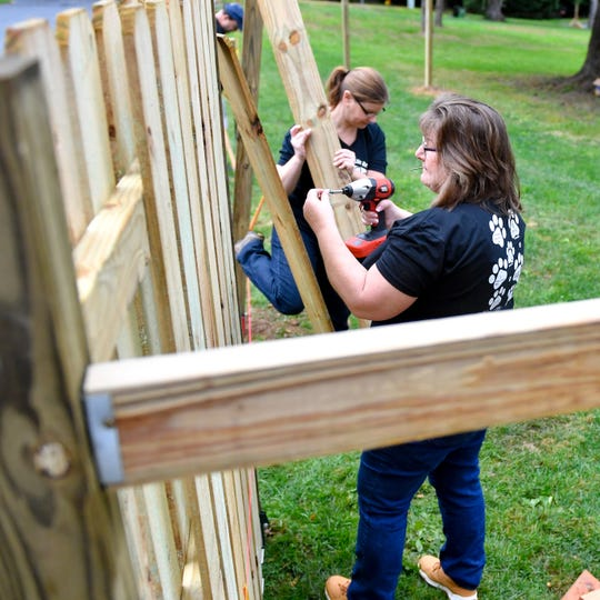 Beth Zimmerman works on fencing at the Rescue Ranch under construction for dogs in Windsor Township.