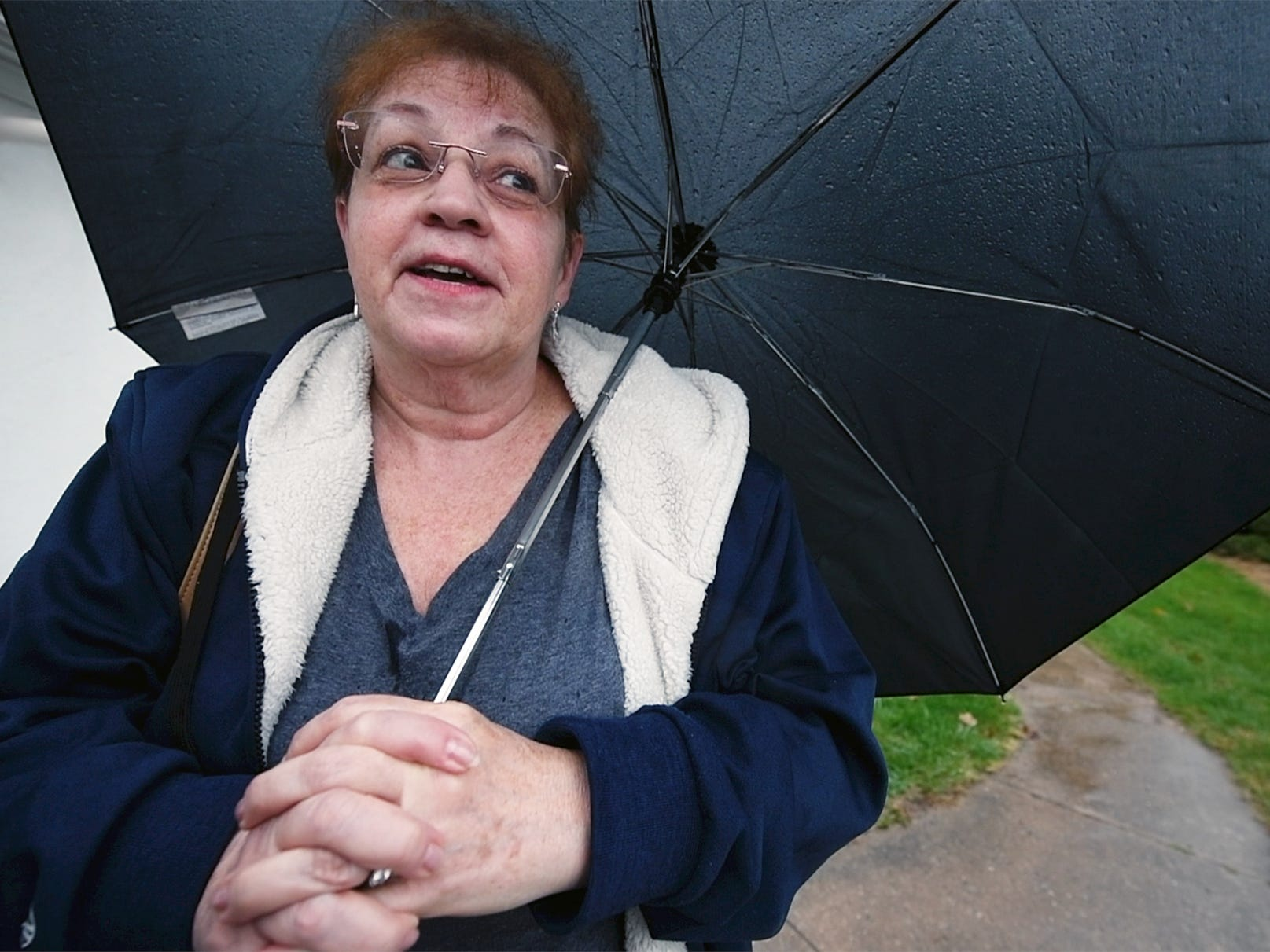 Kathy Zeiders with her umbrella after voting on Election Day in Thomasville.
