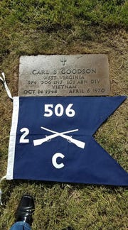 This is Carl Goodson's grave site, with the flag of Charlie Company.