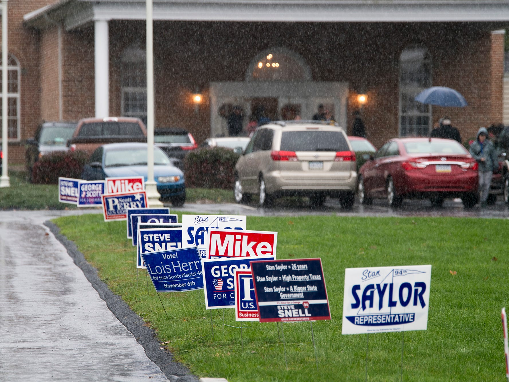 Lines of signs at the Springettsbury Township polling place #8 at Eastside Church on Election Day Tuesday.