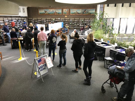 Voters wait to cast a ballot at the Downtown Library on Center Street.