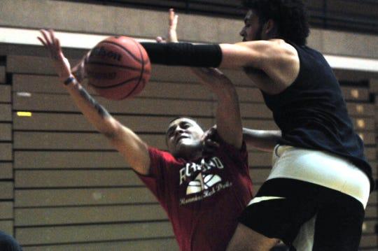 Richmond High School senior Jordan Frye, right, blocks a shot during practice during boys basketball practice Monday, Nov. 5, 2018 at the Richmond High School's Tiernan Center.