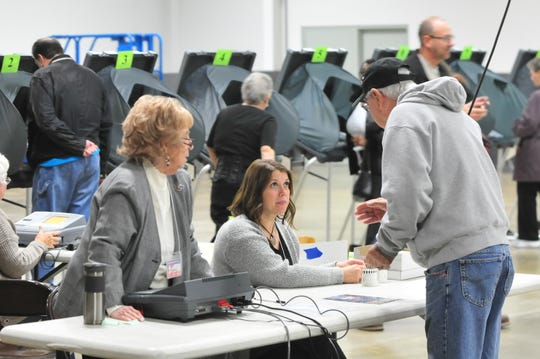 Wayne County voters participate in the 2018 general election by casting their ballots at the vote center in the Kuhlman Center on the Wayne County Fairgrounds in Richmond.