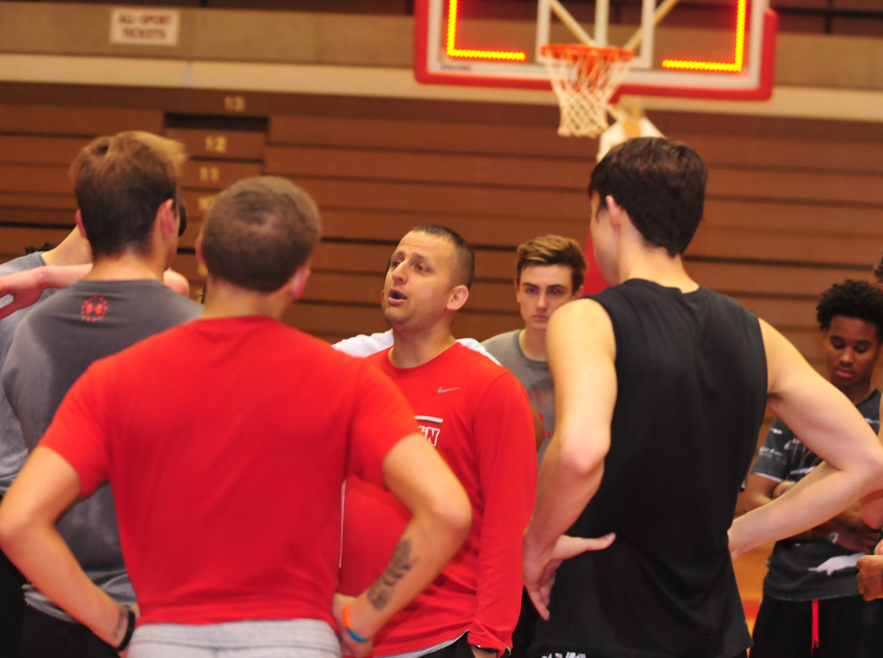 Richmond High School boys basketball coach Shabaz Khaliq talks to players during boys basketball practice Monday, Nov. 5, 2018 at the Richmond High School's Tiernan Center.