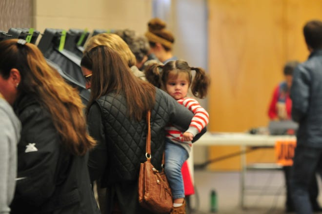 Wayne County residents participate in the 2018 general election by voting at First English Lutheran Church in Richmond.