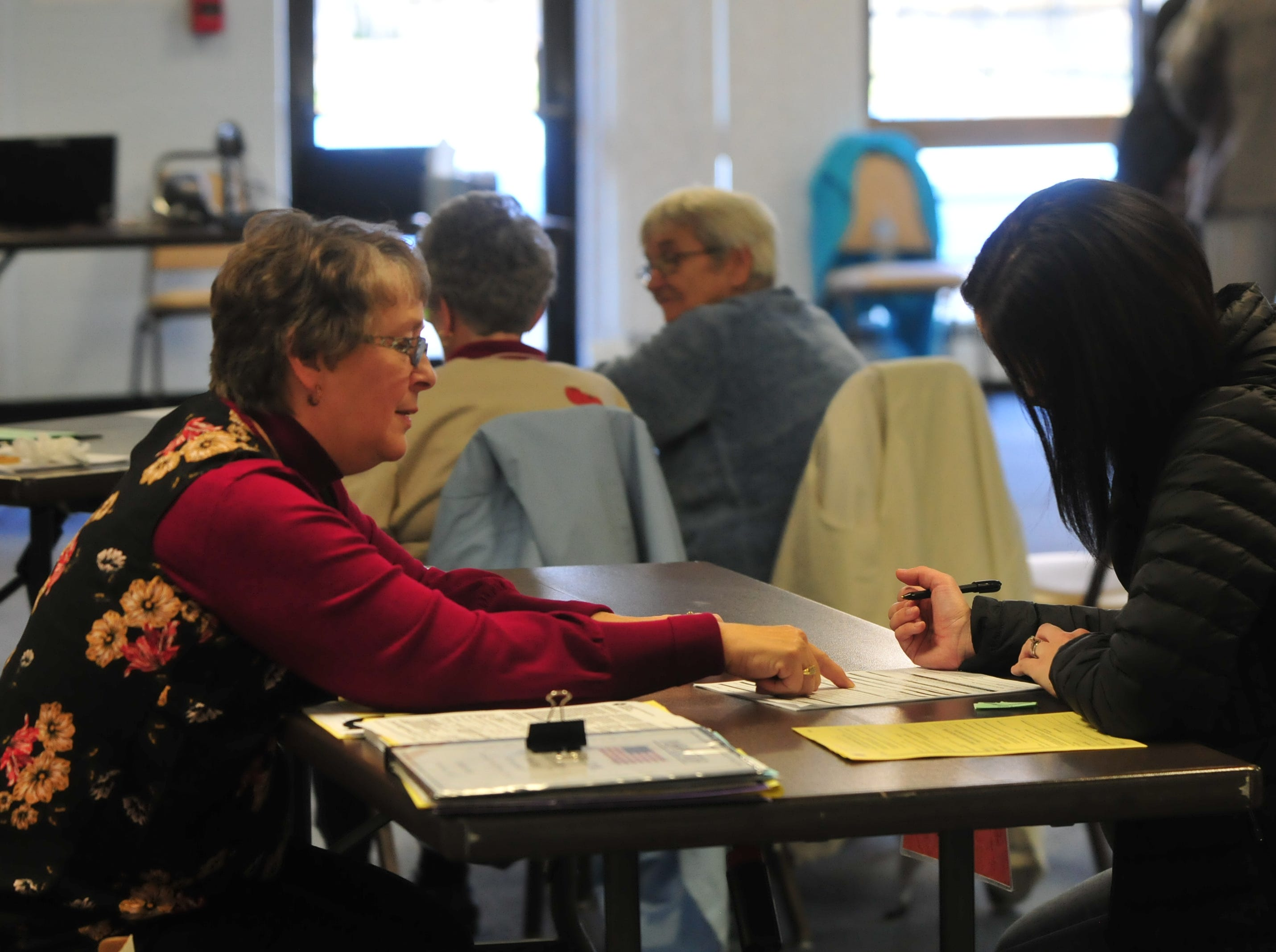 Voters cast their ballots at the Golay Center in Cambridge City on Election Day, Nov. 6, 2018.